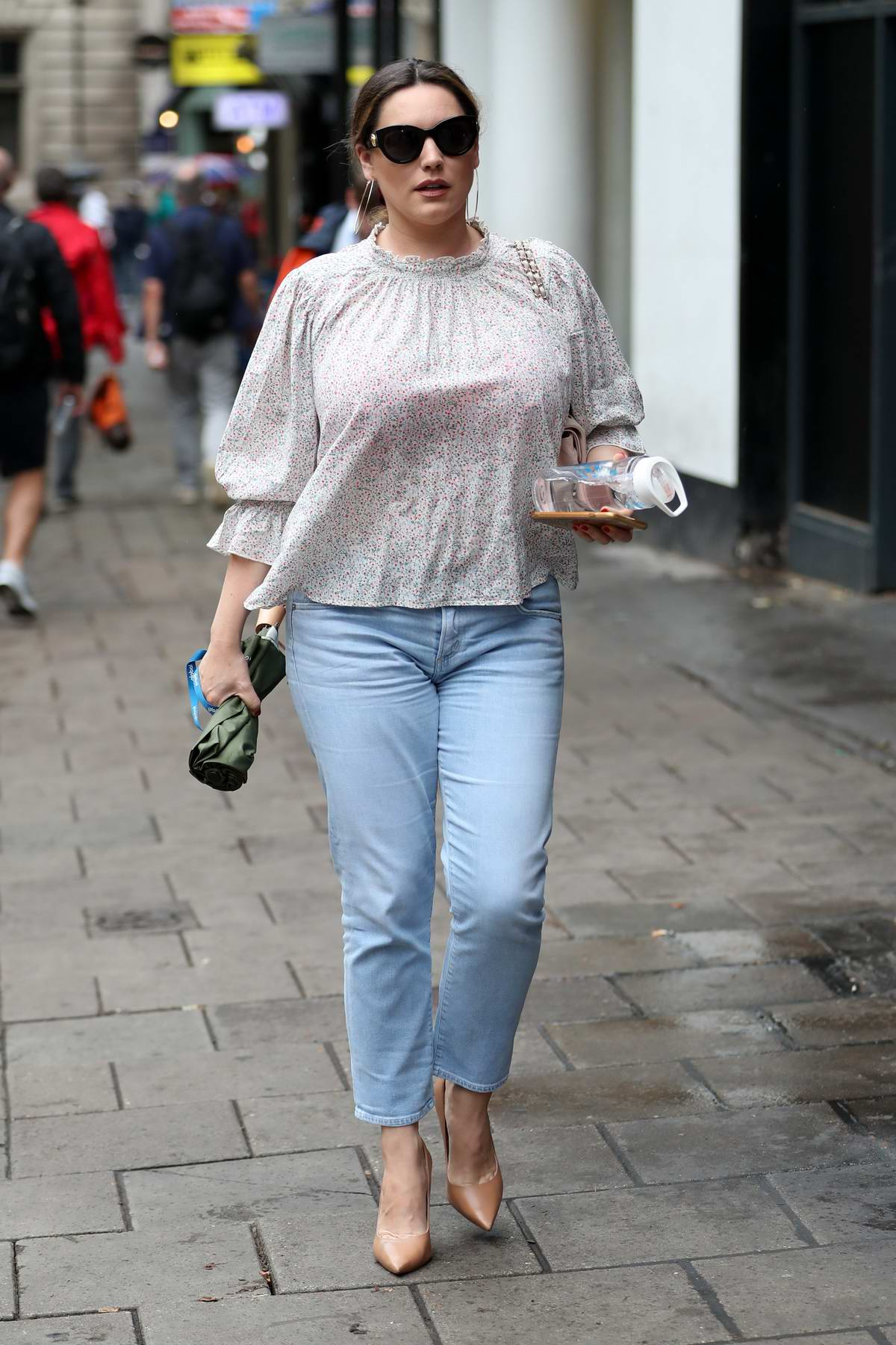 Kelly Brook looks great in a patterned top and jeans while heading to Heart Radio in London, UK
