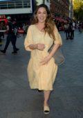 Kelly Brook looks pretty in a light yellow dress as she leaves Global Radio Studios in London, UK