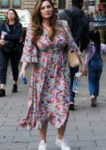 Kelly Brook wears a colorful summer dress and sneakers as she arrives at Global Radio Studios in London, UK