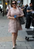 Kelly Brook wears a cute pink summer dress as she arrives for her show on Heart Radio in London, UK