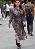 Kelly Brook wears an animal print slit dress as she arrives at Global Radio in London, UK