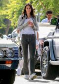 Kendall Jenner looks cool while out for an iced drink with friends at CHa Cha Matcha in West Hollywood, Los Angeles