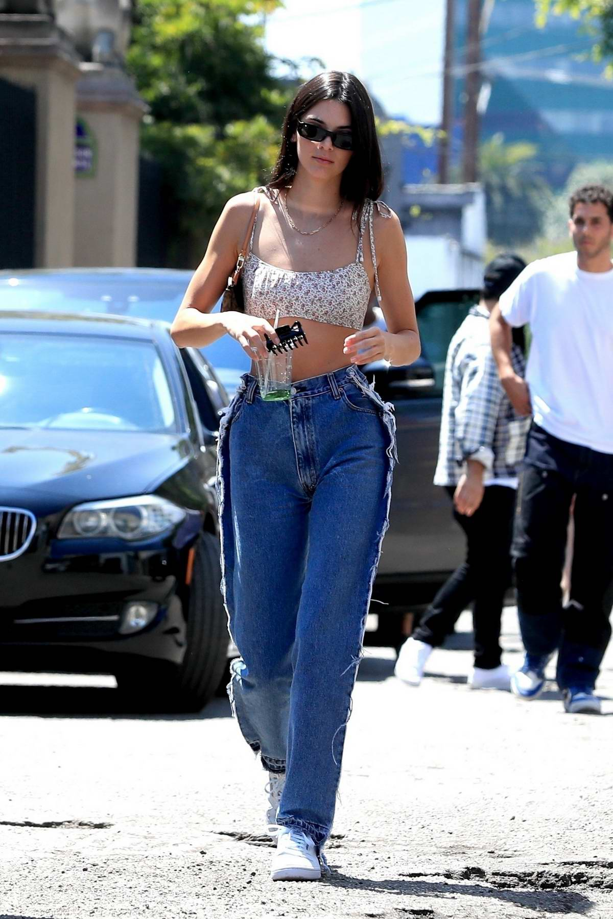 Kendall Jenner looks flawless in tiny crop top and jeans while out with friends in West Hollywood, Los Angeles