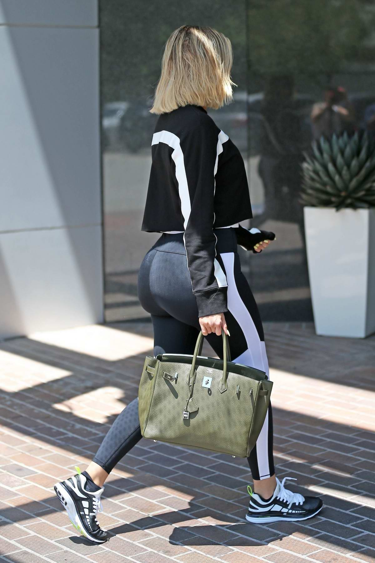 Khloe Kardashian rocked a crop top and leggings as she hits the gym in Los Angeles