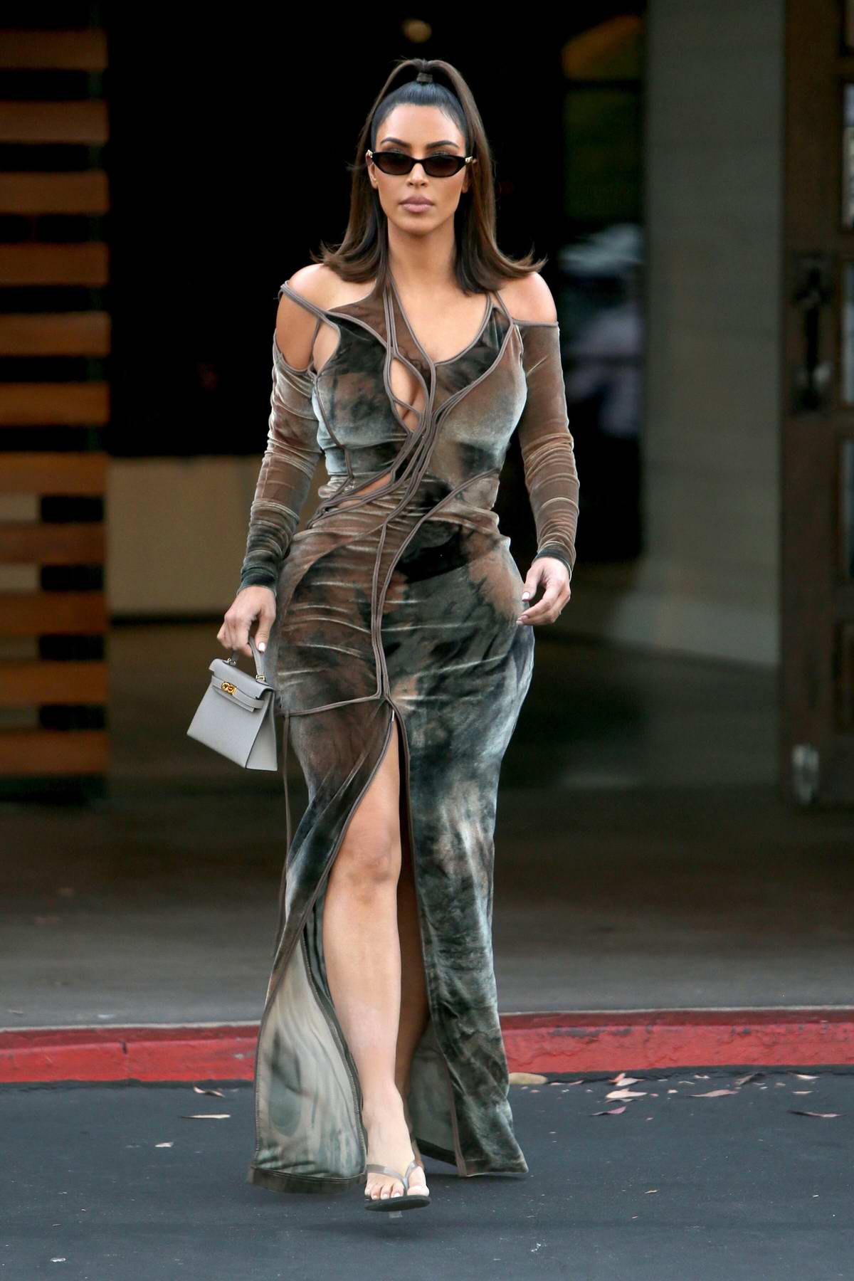Kim Kardashian looks amazing in a form-fitting dress while leaving La Plata Taqueria & Cantina in Agoura Hills, California