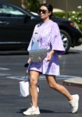 Kim Kardashian rocks her $35k Dior Saddle bag with an oversized lilac t-shirt and white sneakers as she steps out in Malibu, California