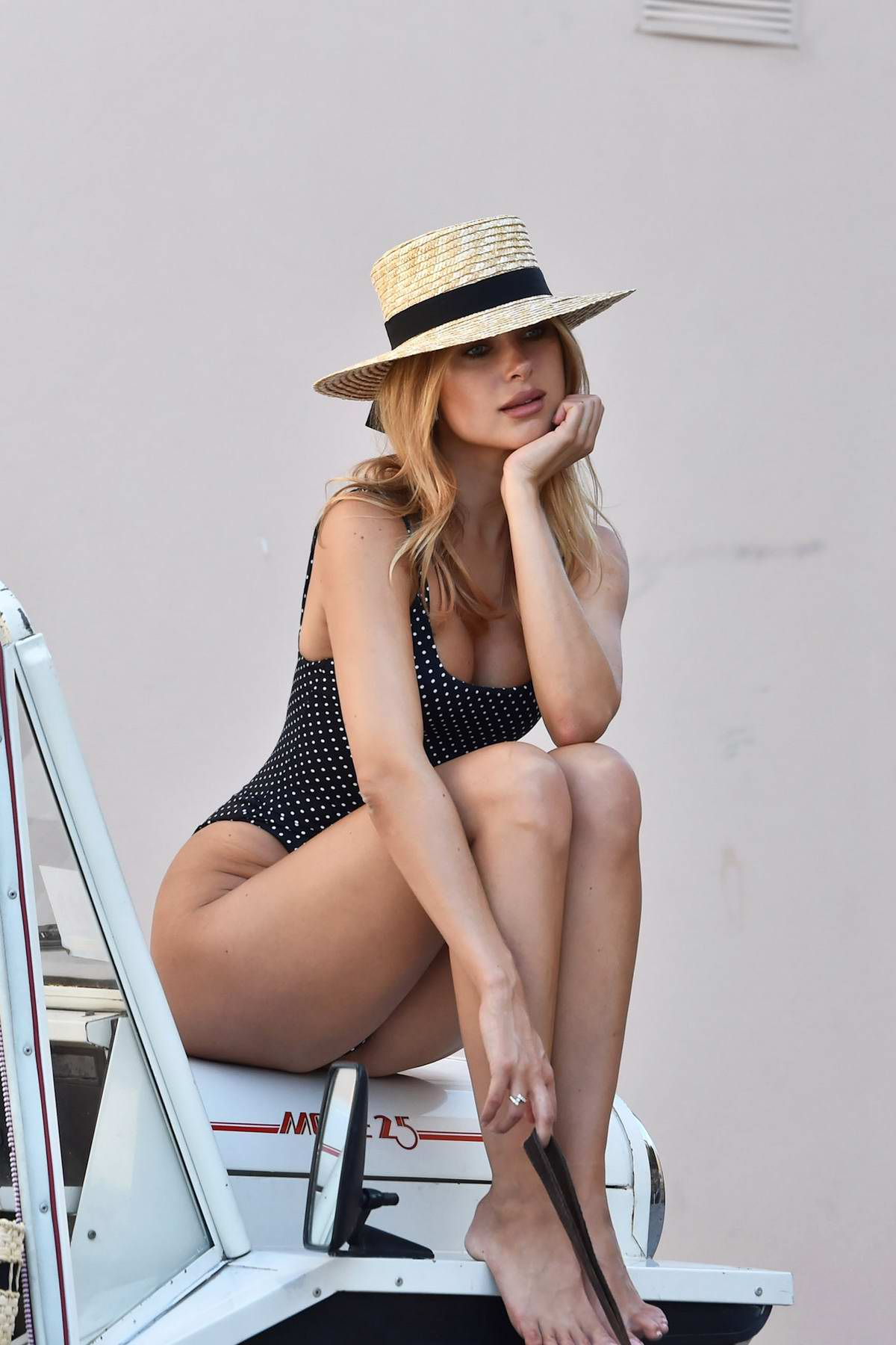 Kimberley Garner sports polka dot swimsuit while posing on the streets of Saint-Tropez, France