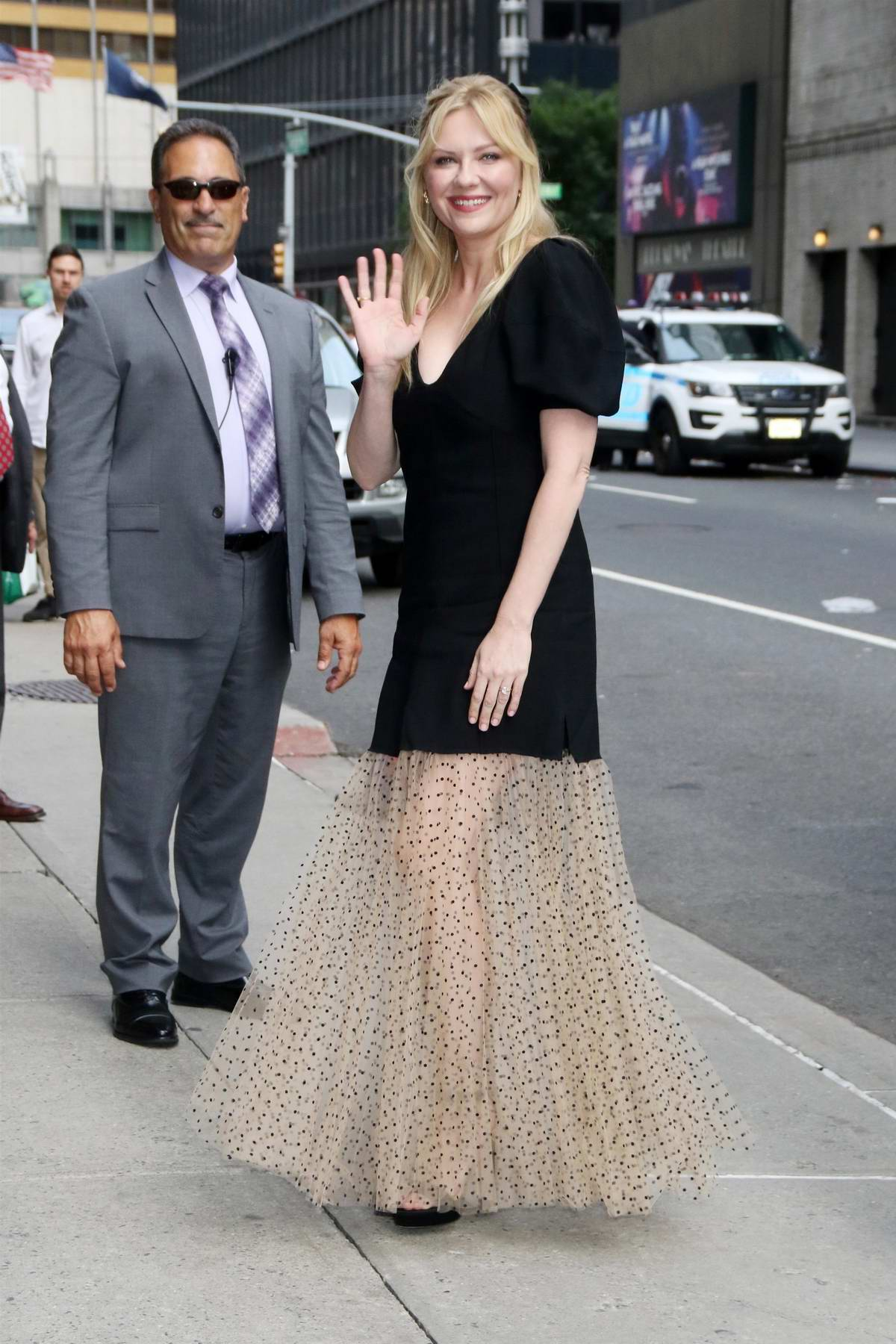 Kirsten Dunst is all smiles as she arrives for an appearance on 'The Late Show with Stephen Colbert' in New York City