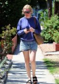 Kirsten Dunst steps out for a stroll wearing a purple top and denim shorts in Studio City, Los Angeles