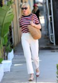 Kirsten Dunst wears striped top and white denim as she leaves the hair salon in West Hollywood, Los Angeles