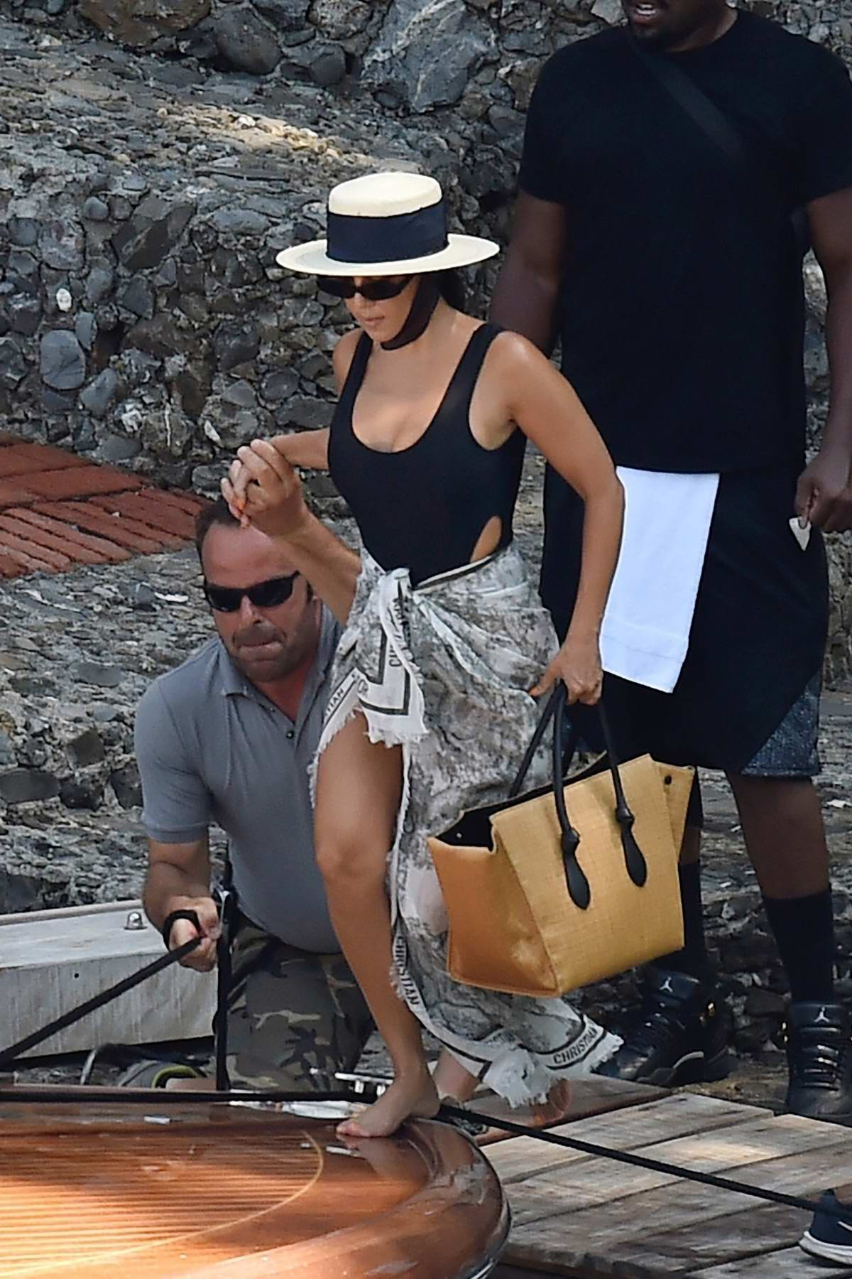 Kourtney Kardashian dons a black swimsuit while enjoying a boat ride during her vacation in Italy