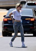Kristen Stewart wears a white crop top and distressed jeans while out running errands in Los Angeles