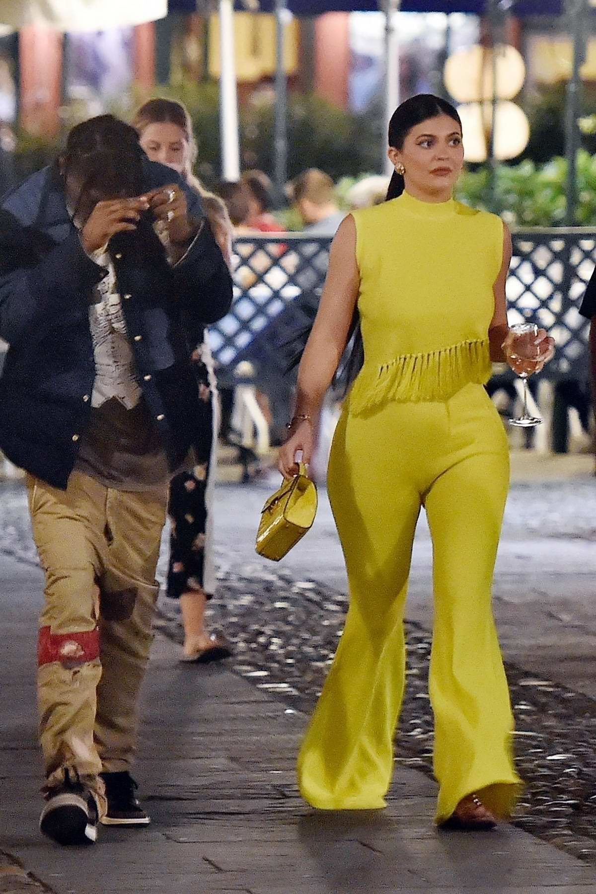 Kylie Jenner dazzles in a bright yellow ensemble while out for a date night with Travis Scott in Portofino, Italy
