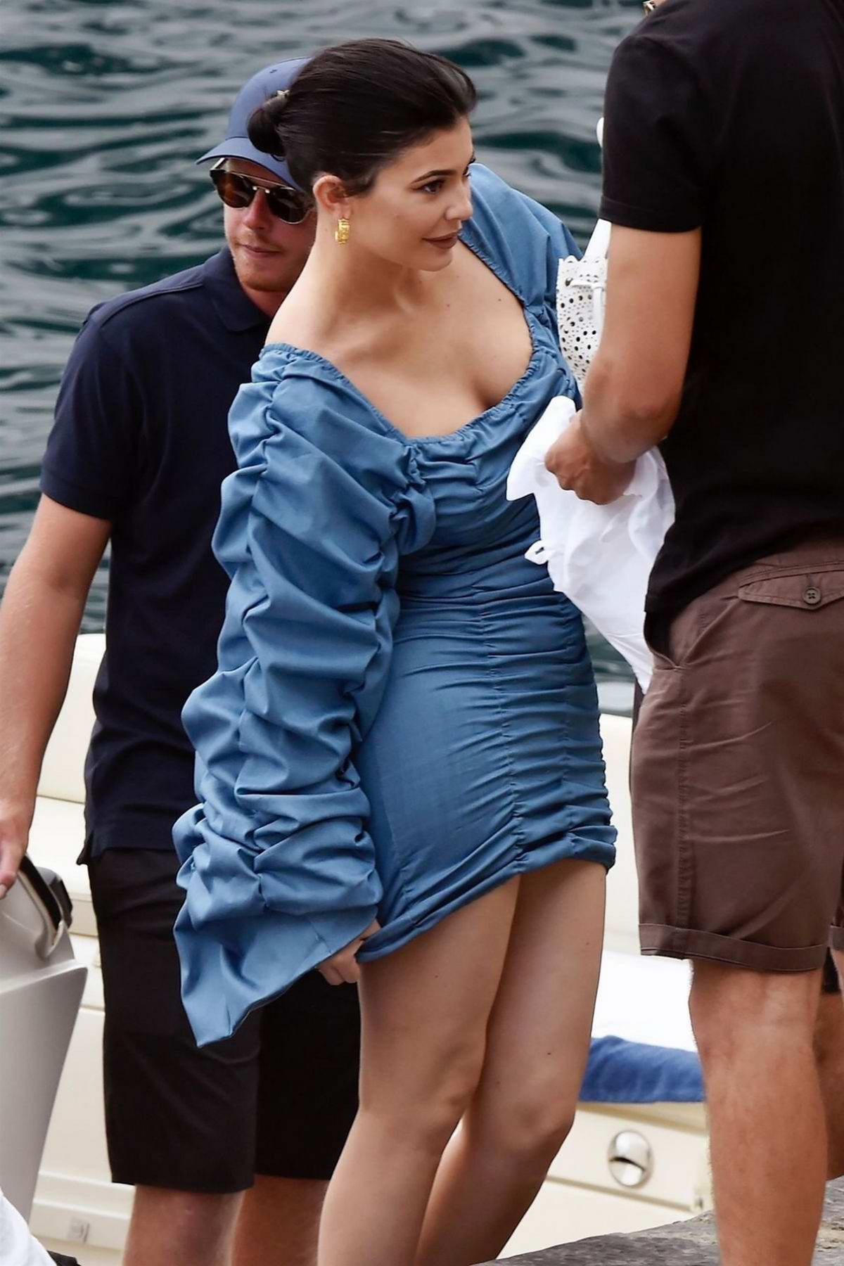 Kylie Jenner looks striking in a blue dress while enjoying a day out with friends in Italy