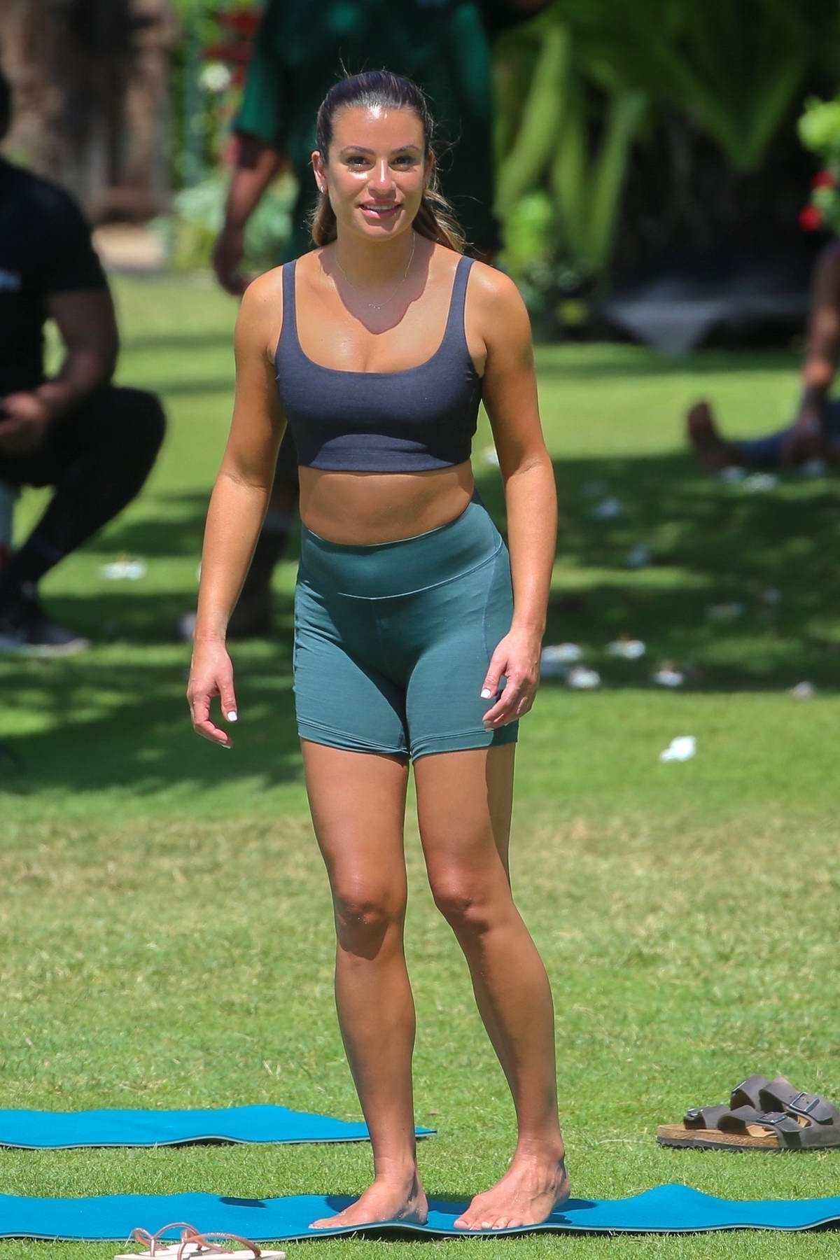 Lea Michele shows off some yoga poses while on the set of 'Same Time Next Christmas' in Hawaii