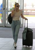 Lili Reinhart wears a simple blush tee and jeans as she arrives at Vancouver airport, Canada