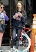 Lily Collins dons black 'Stranger Things' sweatshirt while exiting Dogpound Gym with a friend in Los Angeles