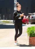 Lily Collins rocked black hoodie and leggings while walking back to her car after a pilates class in Hollywood, California