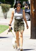 Lucy Hale steps out in a grey tank top and dark green denim skirt as she takes her dog Elvis for a walk in Los Angeles
