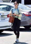 Lucy Hale wears tie-dye top and black leggings for a lunch outing with a friend in Los Angeles