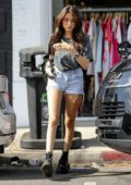 Madison Beer flaunts her legs in denim shorts paired with a vintage Harley Davidson T-shirt during a shopping trip in Los Angeles