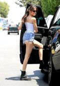 Madison Beer flaunts her slender physique in a white corset top and denim shorts while running errands in Los Angeles