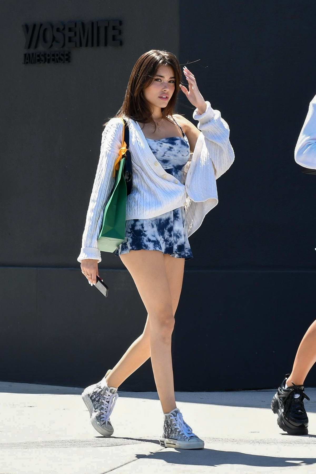 Madison Beer puts on a leggy display in a blue tie-dye mini dress while out with a friend in Los Angeles