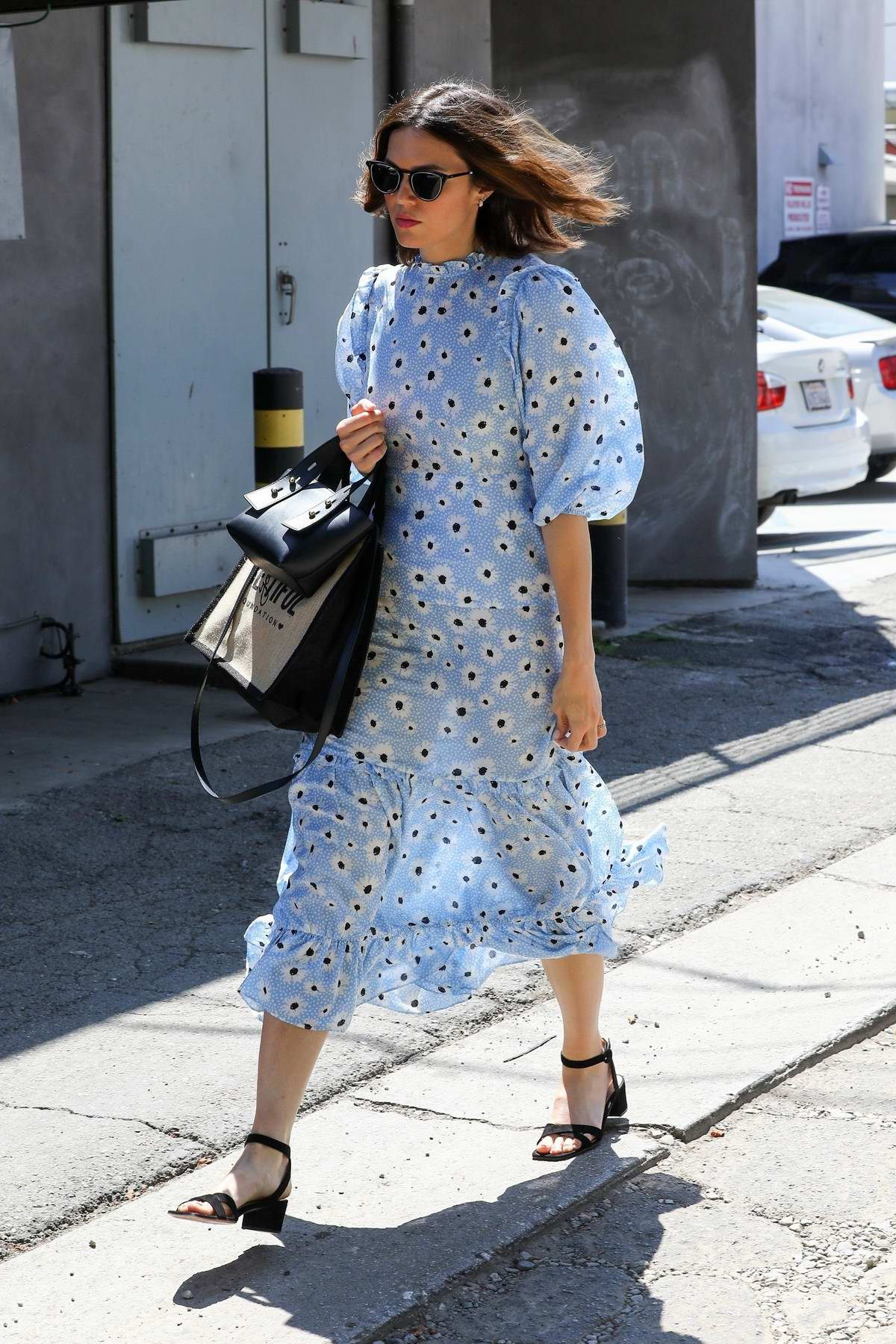 Mandy Moore wears a blue floral dress during a trip to the Nine One Zero salon in West Hollywood, Los Angeles