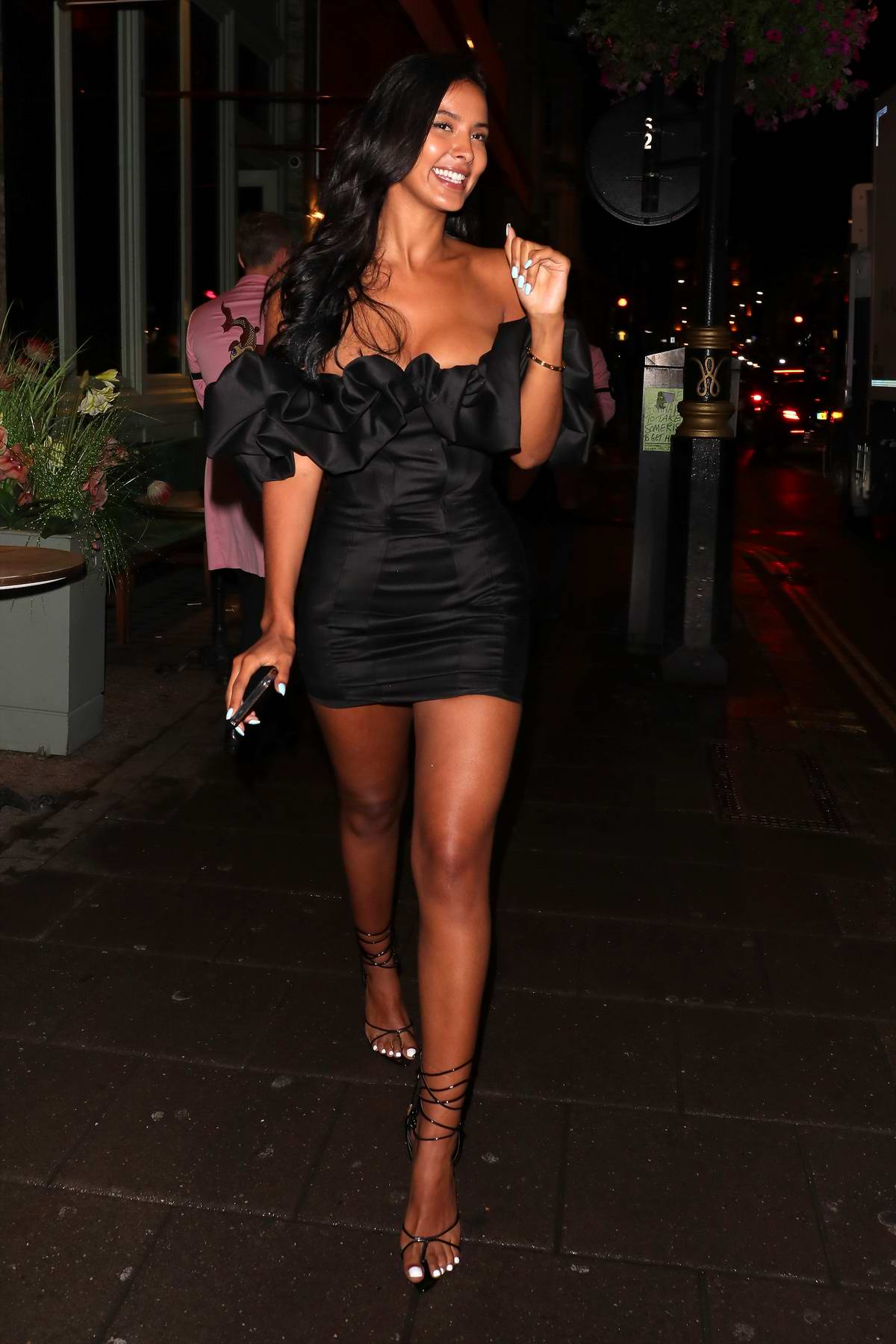 Maya Jama stuns in a short black dress as she celebrates her 25th birthday at Sexy Fish restaurant in Mayfair, London, UK