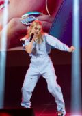 Meg Donnelly performs at Disney D23 Expo 2019 at Anaheim Convention Center in Anaheim, California