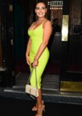Megan Barton-Hanson dazzles in a form-fitting lime green dress during a night out with a friend in London, UK