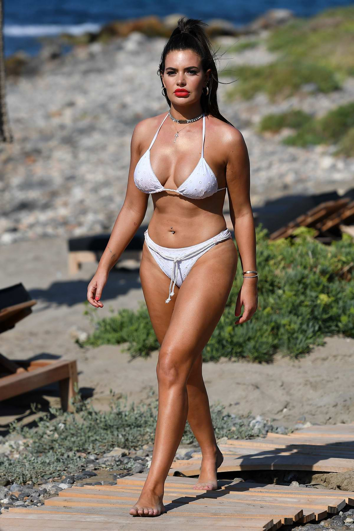 Megan Barton-Hanson sizzles in a white bikini while on the set of 'Celebs Go Dating' TV show in Crete, Greece