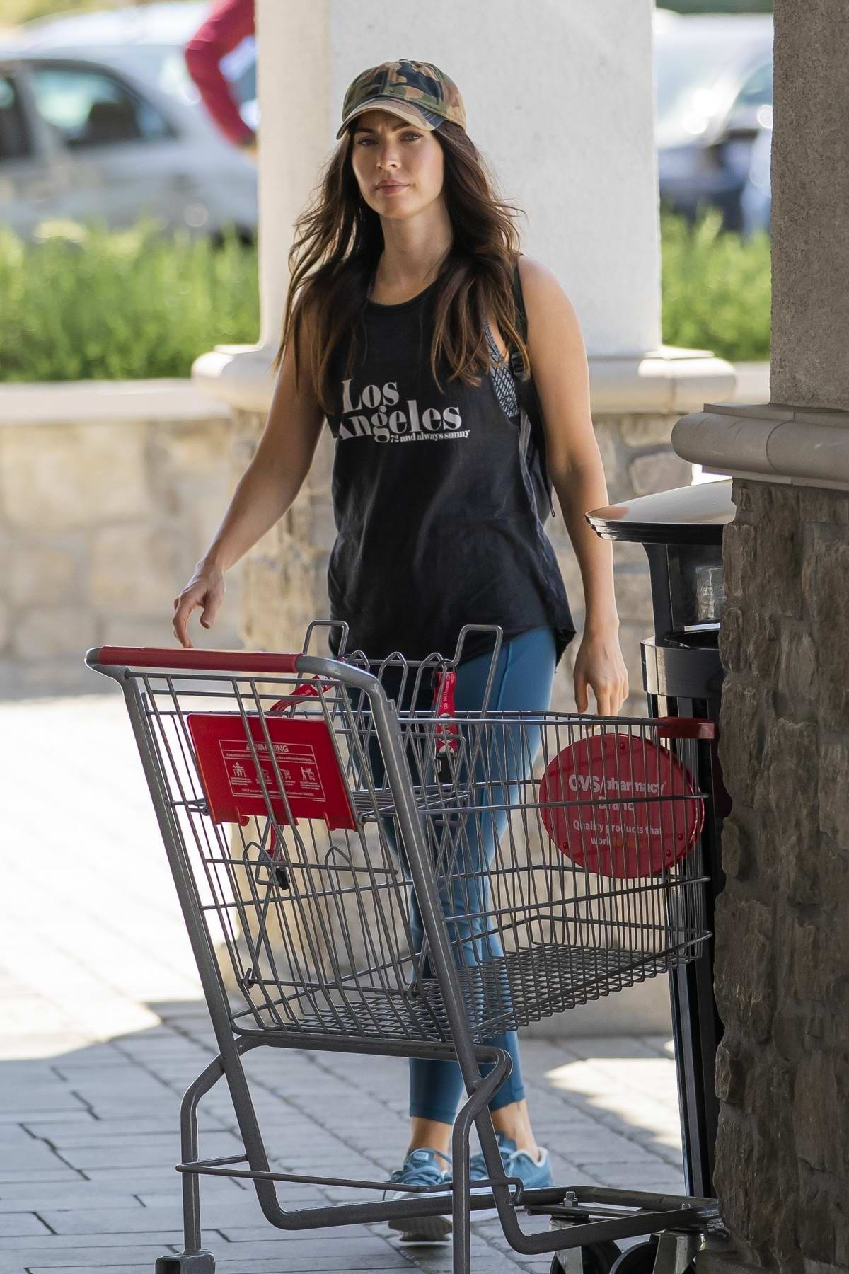 Megan Fox keeps it casual in a black tank and blue leggings while stopping by CVS pharmacy in Los Angeles