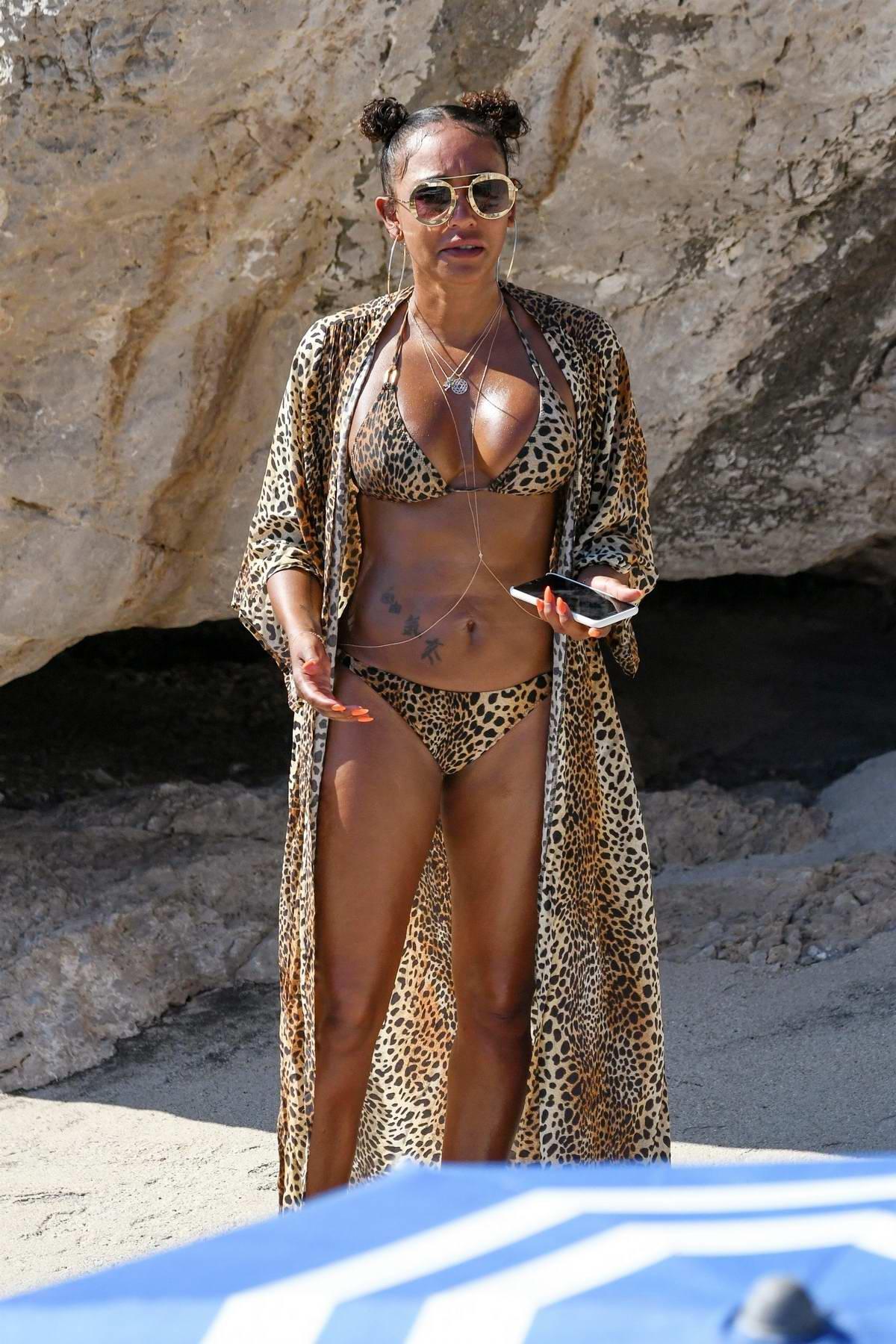 Melanie Brown wears a leopard print bikini while catching some rays in Capri, Italy