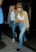 Miley Cyrus and Kaitlynn Carter hold hands during a night out at Up and Down Nightclub in New York City
