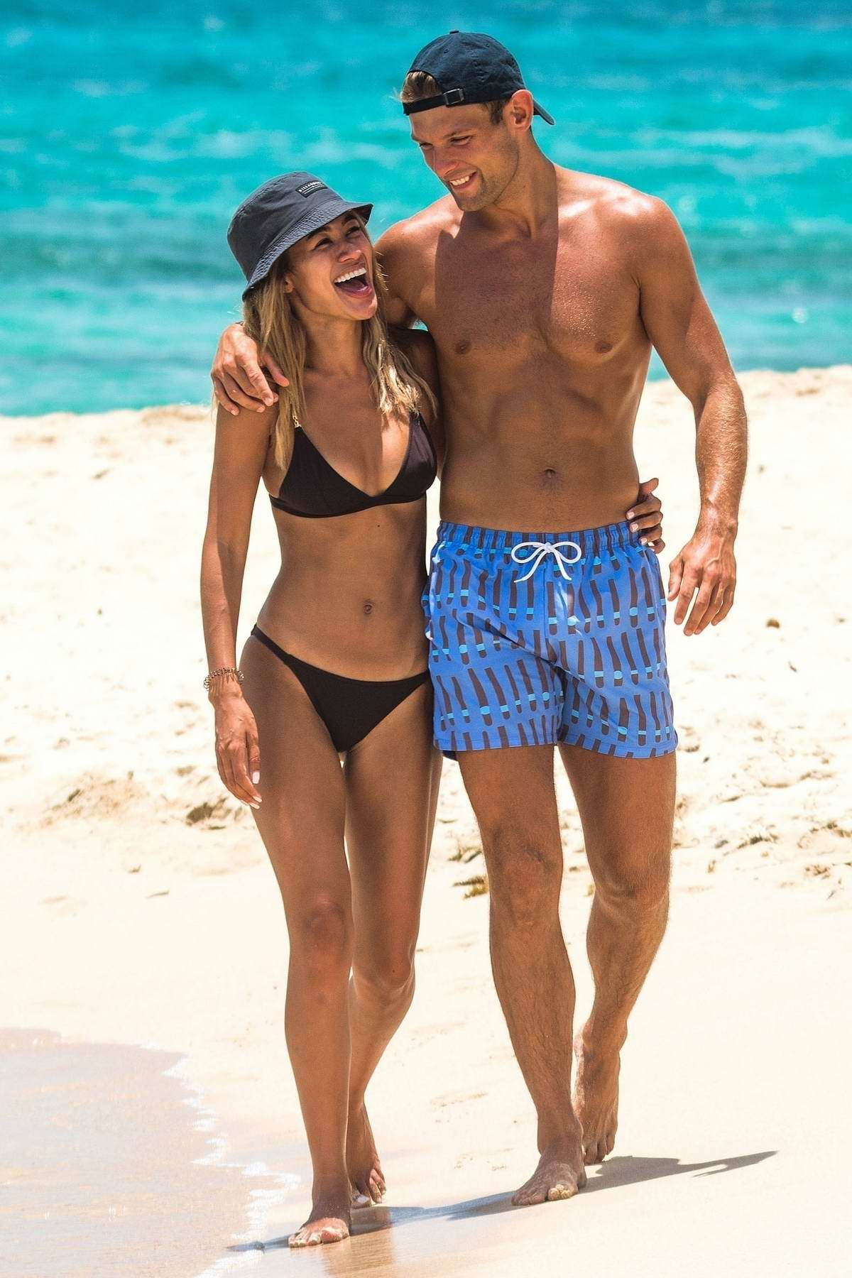 Montana Brown shows off beach body in a black bikini while on holiday with boyfriend Elliott Reeder in Barbados