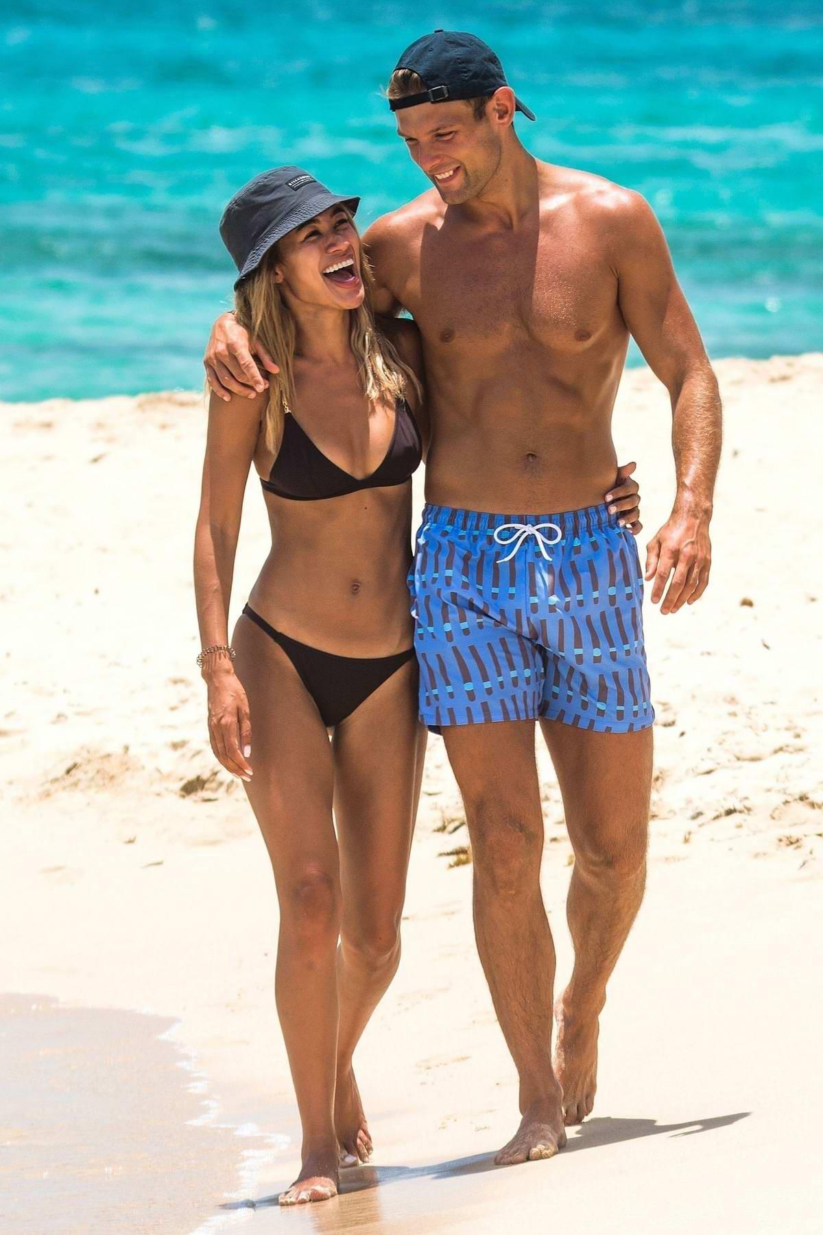 Montana Brown shows off beach body in a black bikini while on holiday with boyfriend Elliott Reeder in Barbados