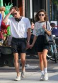 Natalia Dyer and Charlie Heaton hold hands as they step out on a stroll in New York City