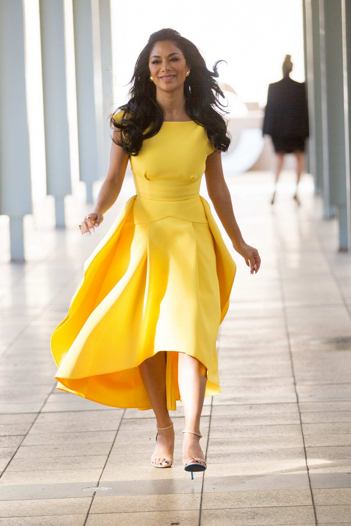 Nicole Scherzinger spotted in a yellow dress leaving after Nova radio interview in Pyrmont, Sydney, Australia