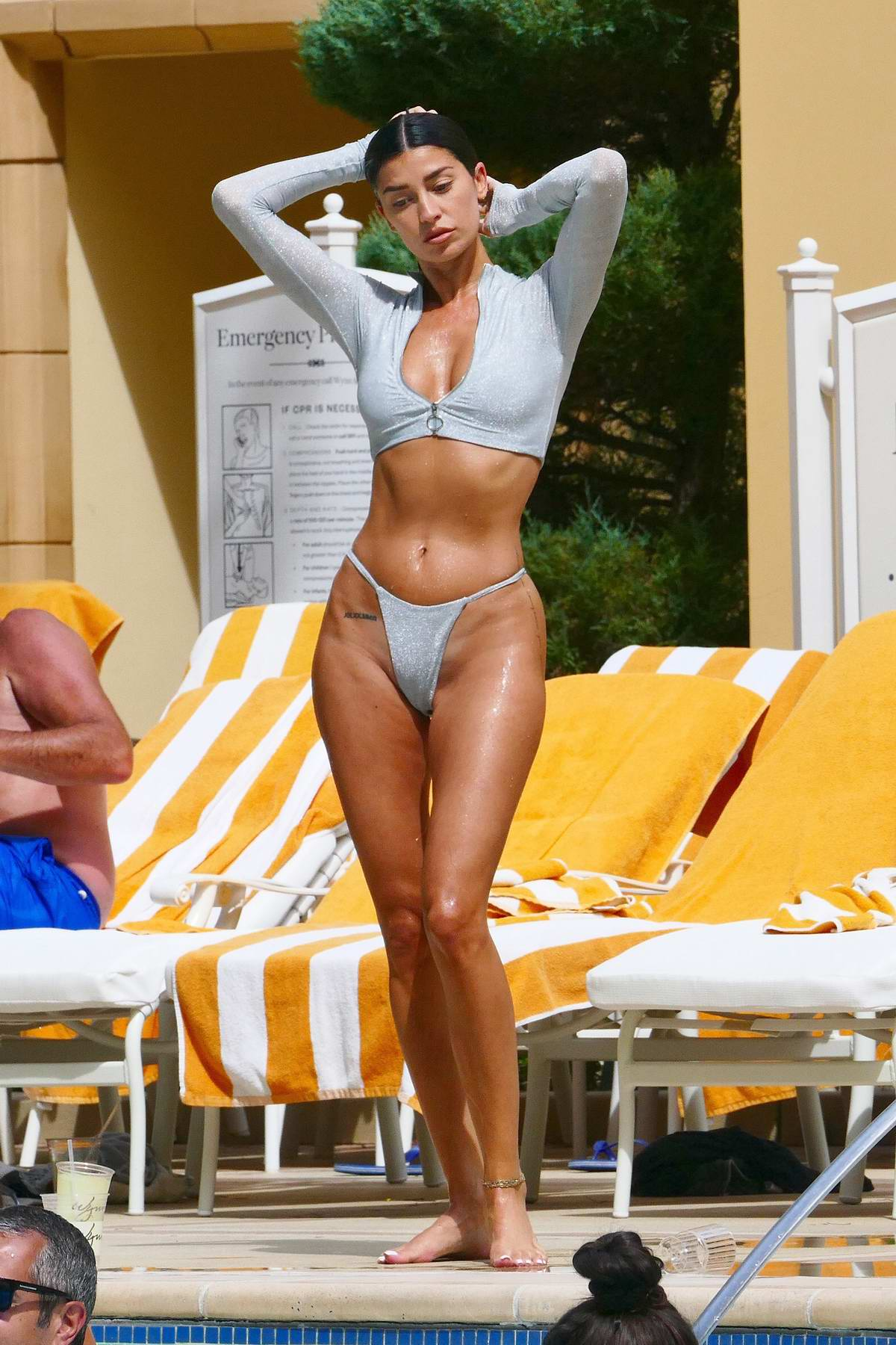 Nicole Williams stuns in a silver bikini as she takes a dip in the pool at her hotel in Las Vegas, Nevada