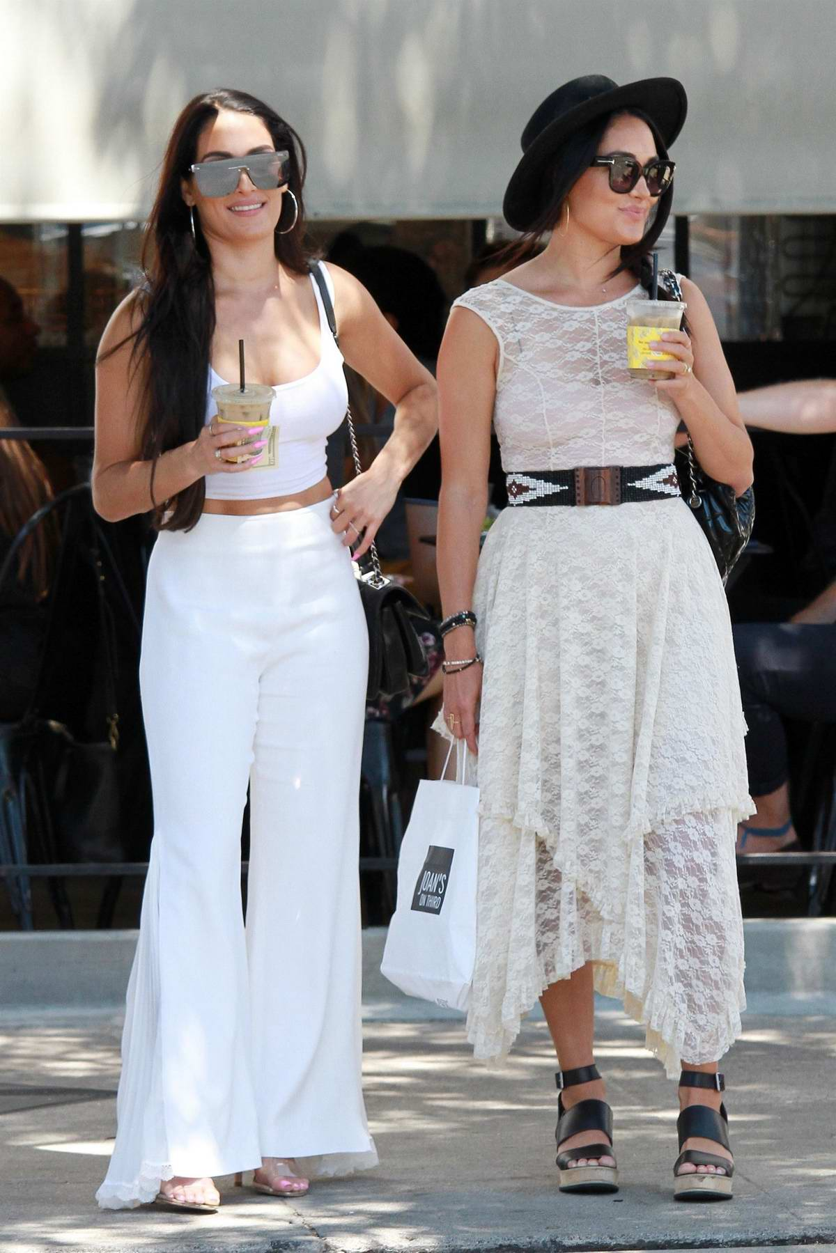 Nikki and Brie Bella step out in all-white ensembles for a lunch outing in Studio City, Los Angeles