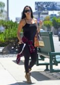 Nikki Bella wears a black top with matching leggings as she heads to the gym in Los Angeles