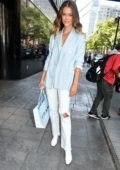 Nina Agdal looks stylish in a baby blue blazer and ripped white jeans as she steps out in New York City