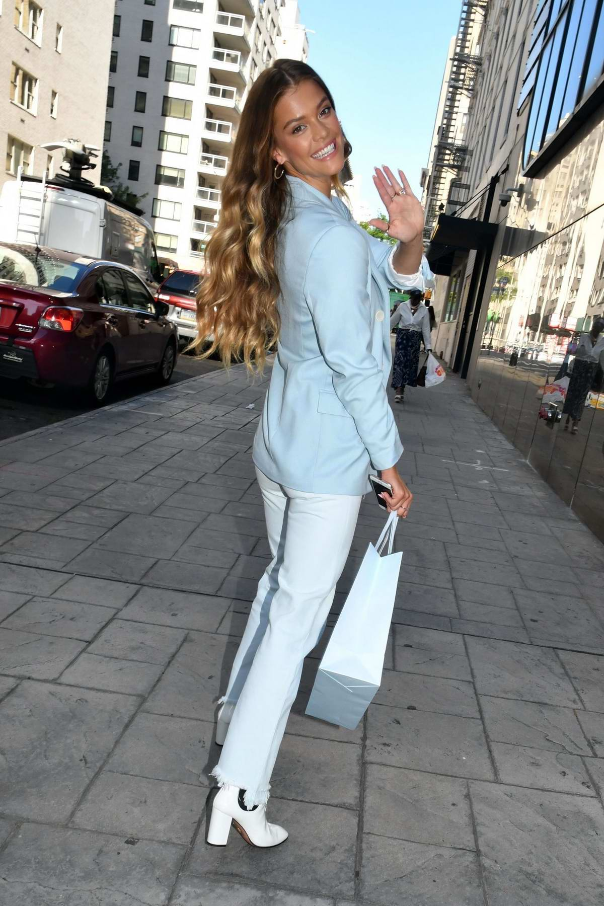nina agdal looks stylish in a baby blue blazer and ripped ...