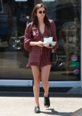 Nina Dobrev ditches her crutches for a foot brace during a lunch outing in Los Angeles