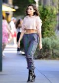 Olivia Culpo looks striking in stylish pants paired with a crop top while out in Los Angeles