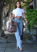 Olivia Culpo makes a quick change and picks up some flowers while out in Los Angeles