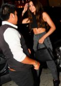 Olivia Culpo shows off her rock hard abs in a black crop top during a night out with Cara Santana at Catch LA in West Hollywood, Los Angeles
