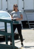 Olivia Munn dressed casual in a grey t-shirt and black trousers on the set of 'Violet' in Los Angeles