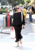 Olivia Palermo keeps it chic in all black as she steps out for a walk in Brooklyn, New York City